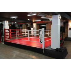 Ринг боксерский с боев. зоной 5 х 5 м., на помосте 6 х 6 м. высотой 1 м.
